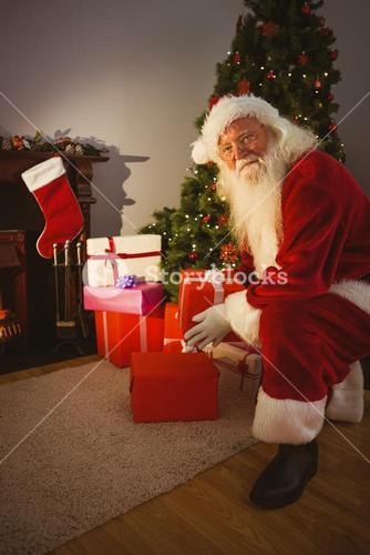 Happy santa delivering gifts at christmas eve