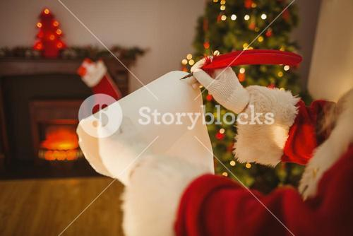 Father christmas writing with a quill