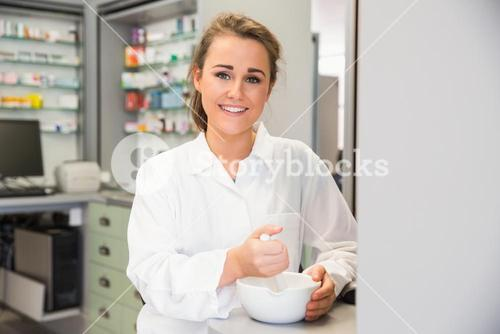 Junior pharmacist mixing a medicine