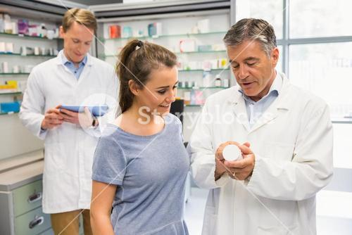 Happy customer talking with pharmacist
