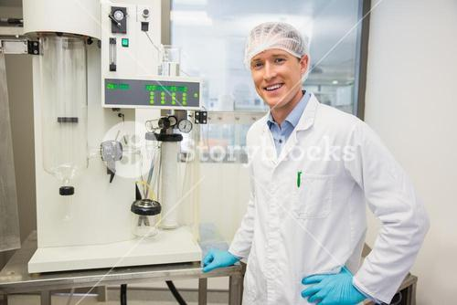 Pharmacist using machinery to make medicine