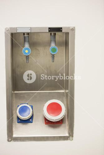 Blue and red buttons on the wall