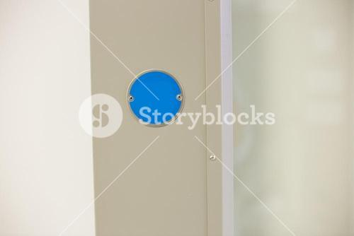 Blue button on the wall