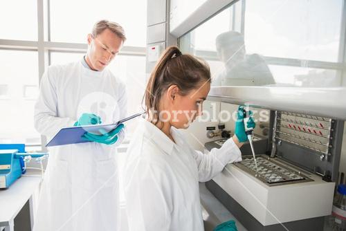 Young scientist using a pipette in chamber