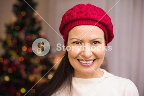 Portrait of a smiling brunette in red hat