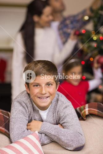 Smiling son leaning on the couch