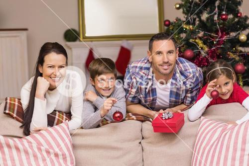 Happy family leaning on the couch