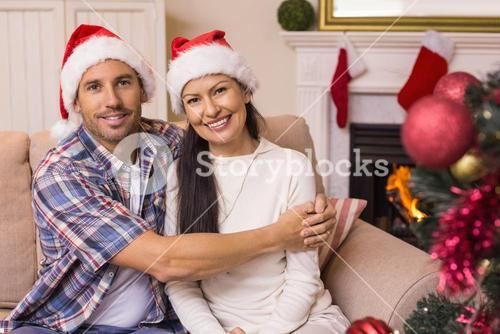 Festive couple hugging on the couch