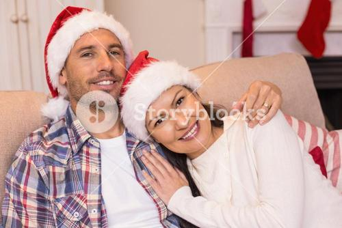 Love couple hugging on the couch