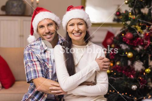 Smiling couple in cuddling on the couch
