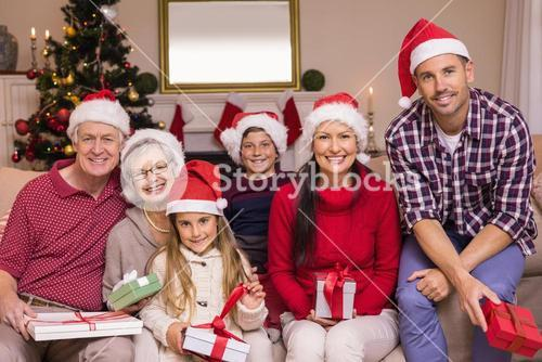 Multigeneration family wearing santa hats on the couch