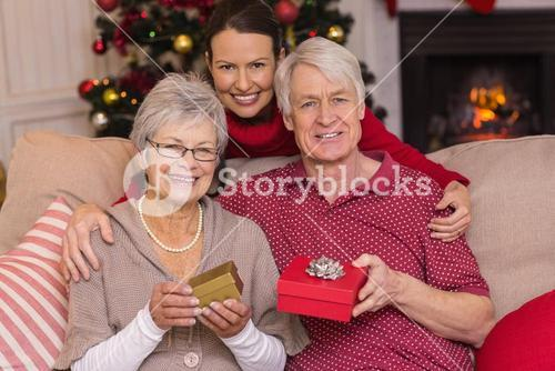 Mother posing with grandparents at christmas