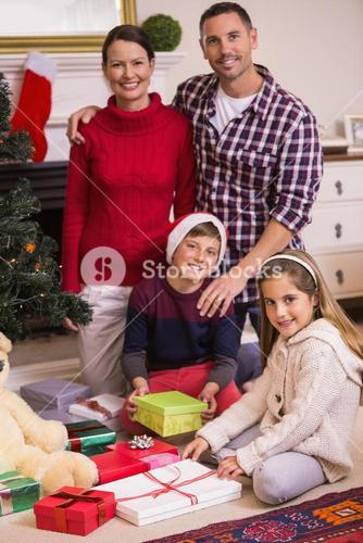 Happy family opening present at christmas