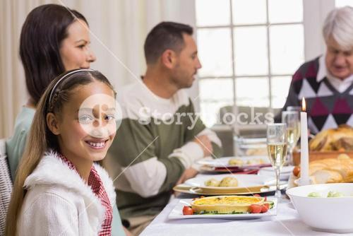 Portrait of a smiling girl at christmas dinner
