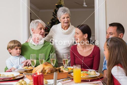 Happy family talking together at christmas dinner