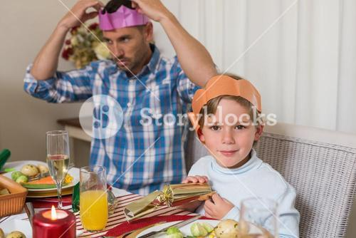 Portrait of father and son in party hat