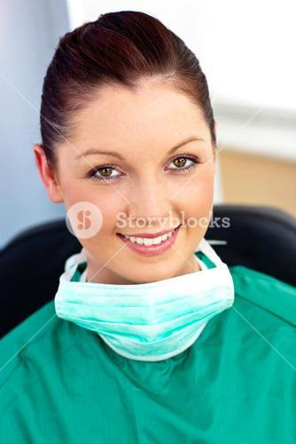 Assertive female doctor with scrubs sitting in her office