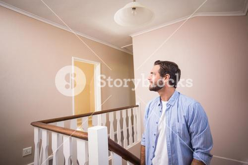 Casual man walking up the stairs
