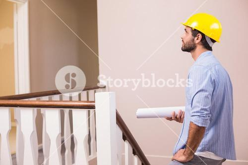 Casual architect walking up the stairs