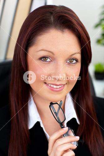 Glowing businesswoman holding glasses