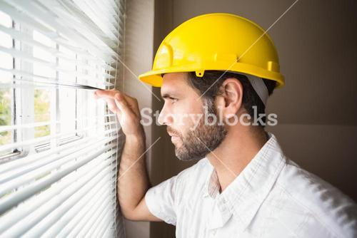 Handyman looking out the window