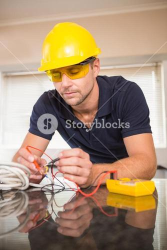 Construction worker working on cables