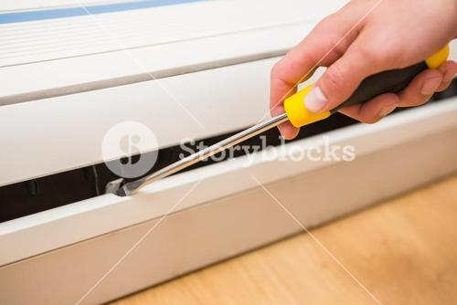 Handyman fixing an air conditioning