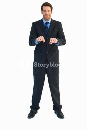 Businessman raising his clenched fists in front of him