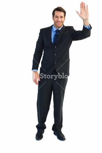 Smiling businessman salute with hand up