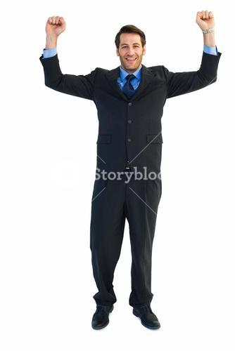 Portrait of a cheerful businessman with clenched fists