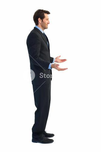 Businessman standing with arms out