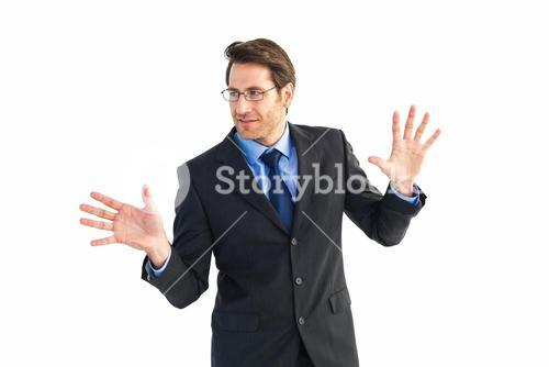 Businessman standing with fingers spread out