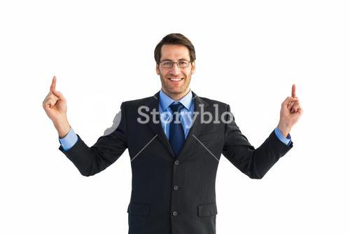 Smiling businessman pointing with both fingers