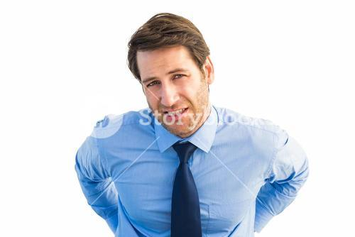 Handsome businessman with back pain standing