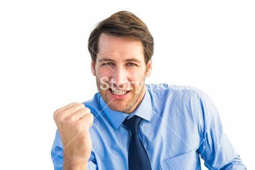 Cheerful businessman clenching fist looking at camera