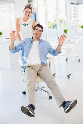 Man on swivel chair with hands up