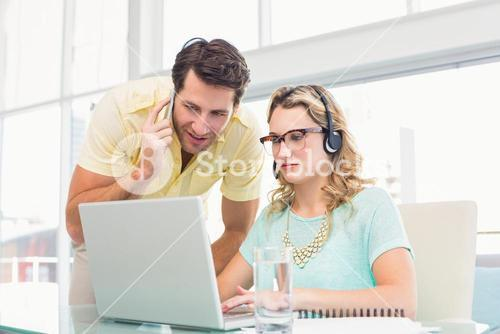 Pretty designer with headphone working on computer