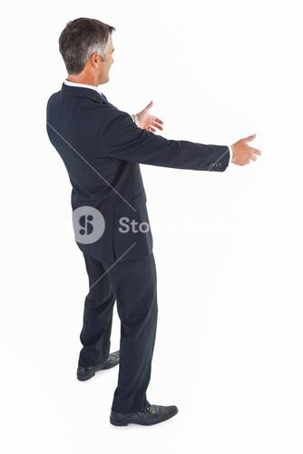 Happy businessman with arms out
