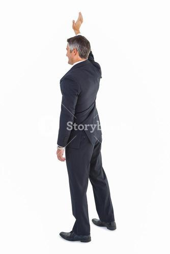 Isolated businessman in suit waving