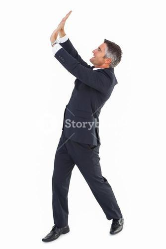 Happy businessman with his arms up