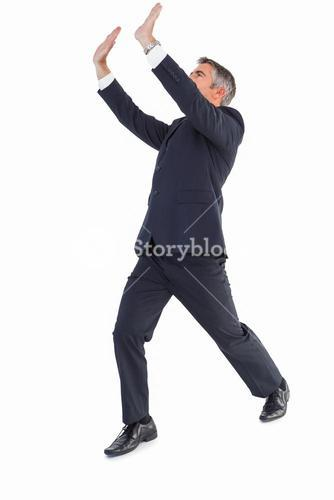 Businessman in suit with arms up