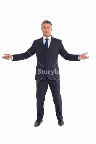 Cheerful businessman spreading his arms