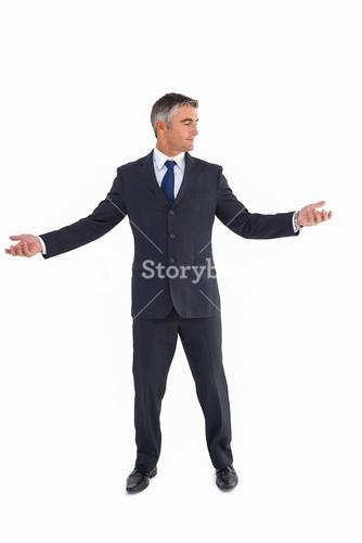 Businessman in suit spreading his arms