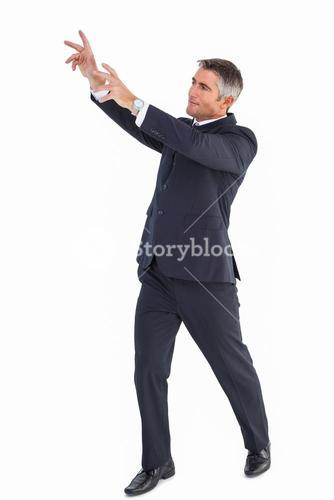 Happy businessman standing with arms up