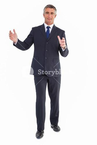 Smiling businessman standing with arms out