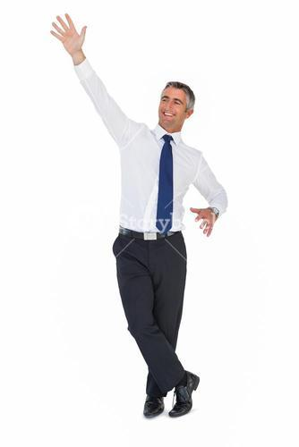 Portrait of a smiling businessman waving
