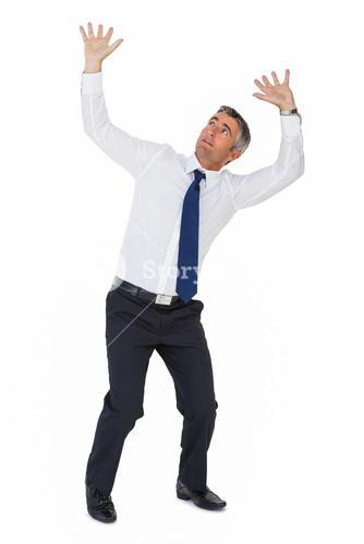 Businessman looking up with arms up