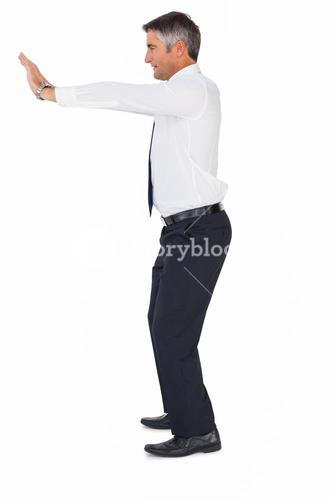 Side view of a businessman pushing