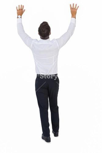 Rear view of a businessman with arms up