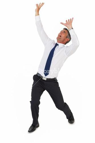 Businessman screaming with arms up